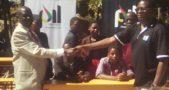 Kadango (R) making the donation