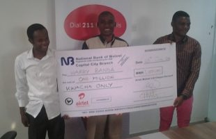 Harry Banda gets Cheque from Airtel