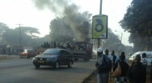 KCN Students burning tyres in the middle of the road