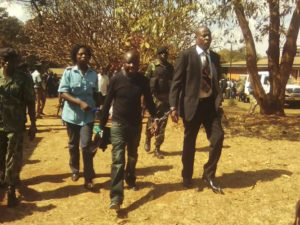 Manondo and Kumwembe handcuffed after conviction enroute to Prison