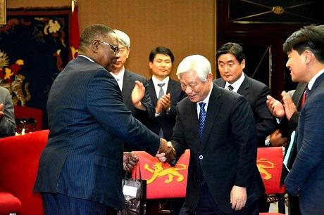 Pr Ock Soo Park, and Peter Mutharika