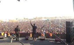 Andrew Palau preaching to thousands of Malawians