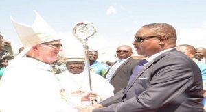 Peter Mutharika with Bishop John Ryan