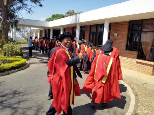 Dr Ngwenya on cloud nine; gives thumbs up during the graduation procession