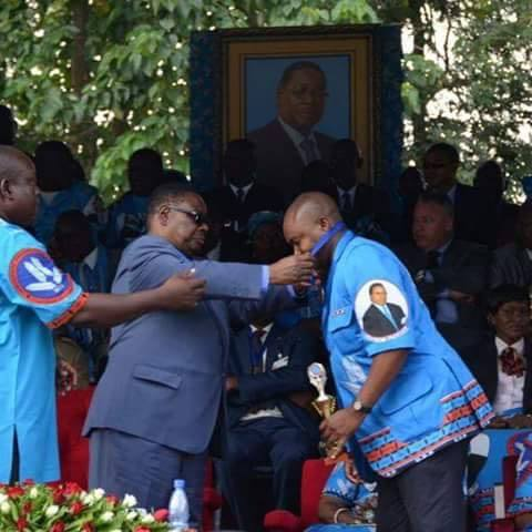Dissi being awarded by Mutharika for being a loyal servant