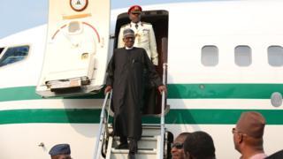 Buhari walks off plane unaided