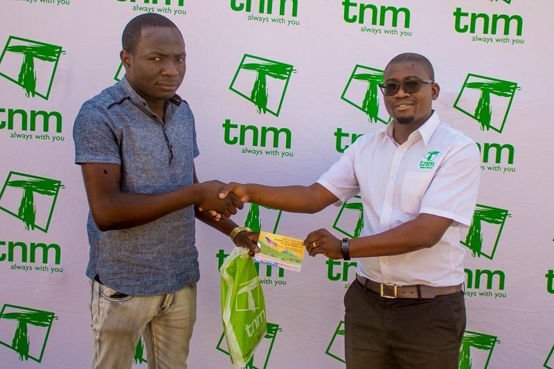 NM's Chimwemwe Mganga( R) presenting ticket to Mwanja