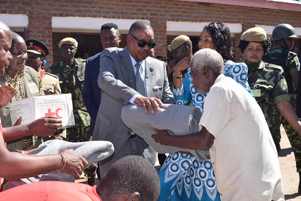Peter Mutharika serving flood victims